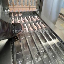 供应鸡爪520拉伸膜全自动真空包装机价格多少