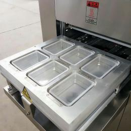 JCQT-4熟食卤菜盒装真空充氮气包装机