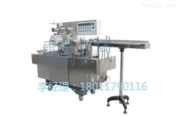 XT-180可调式透明膜三维包装机(带防伪易拉线)